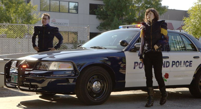 by: COURTESY OF SCOTT GREEN/IFC - These Portland cops are very fashionable. Of course, it's Fred Armisen and Carrie Brownstein from IFC's 'Portlandlia' episode in which Fred and Carrie try to redesign the Portland Police Bureau uniforms. Some Portland police officers, and their patrol cars, have been extras on the comedy.