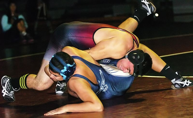 by: DAN BROOD - QUICK PIN -- Sherwood senior Ryan Jurgens (top) wasted no time in pinning Liberty's Jose Alaguna in their 195-pound match.