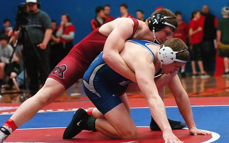 by: DAN BROOD - TIMBERWOLF ON TOP -- Tualatin senior Luke Goessens (left) has a grasp of McNary's Zach Hammerschmith early in their 182-pound title match.