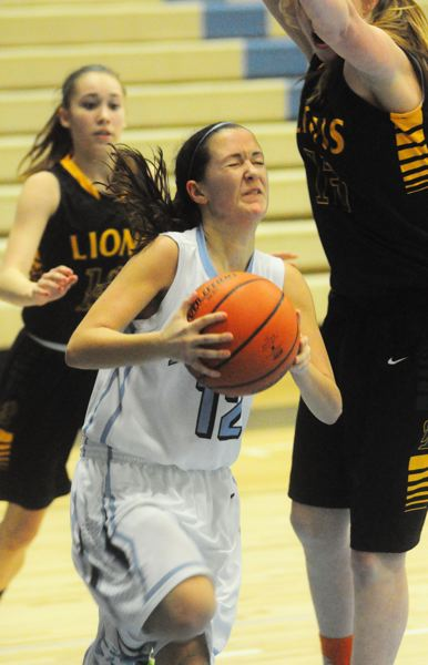by: MATTHEW SHERMAN - Lakeridge's Colleen Ellis anticipates drawing contact on a drive to the basket during Friday's home game against West Linn. Ellis led the Pacers with 10 points in the game.