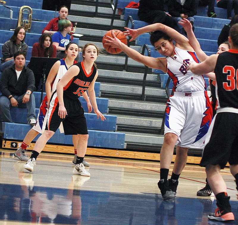 by: BILLY GATES/THE PIONEER - Madras forward Janae Adams grabs a rebound during the White Buffalos' 60-40 win against Molalla.