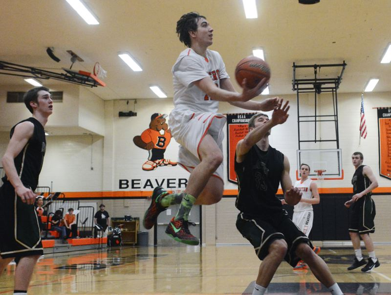 by: TIMES PHOTO: MATT SINGLEDECKER - Beaverton senior guard Ty Peacock soars to the hoop for a lay-up during the Beavers 51-49 loss to Jesuit.