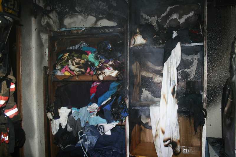 by: PHOTO COURTESY OF WOODBURN FIRE DISTRICT - A house fire on Olive Avenue in West Woodburn displaced an extended family. The fire started in the shelving unit of one of the bedrooms.
