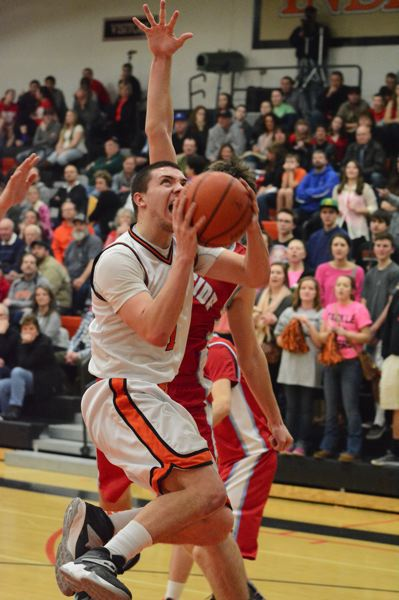 by: JOHN WILLIAM HOWARD - Senior guard Tracy Scruggs fights past the Seaside defense for a layup during the Indians' loss to the Gulls on Feb. 18. Scappoose controls their own destiny moving forward: if they win, they're in the playoffs for sure.