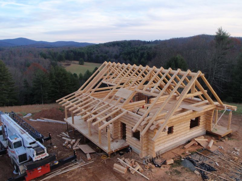 by: CONTRIBUTED PHOTO - In one of his first projects to come out of his new location on Marmot road, Mark Fritch and employees created a log home materials package to be reassembled on an 80-acre lot in Virginia.