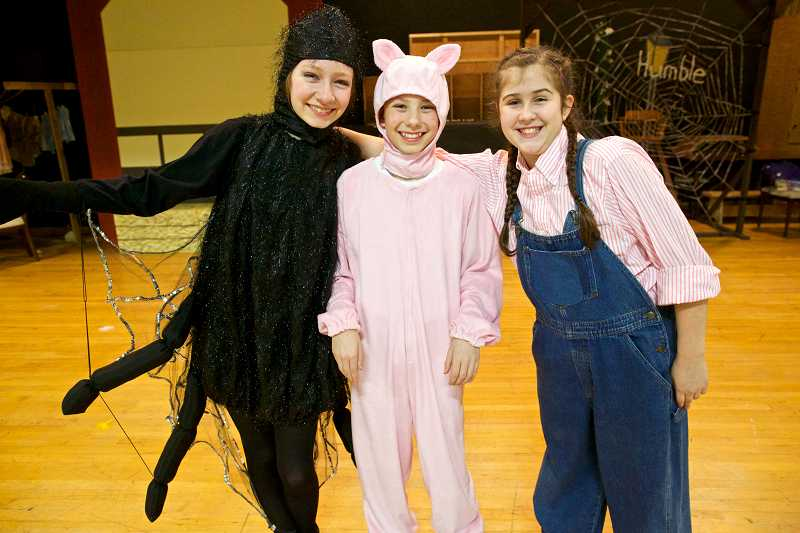 by: TIMES PHOTO: JAIME VALDEZ - Hadley Carlberg, an eighth-grader, and seventh-graders Jacob Doss and Riley Green rehearse their roles in Twality Middle Schools production of Charlottes Web.