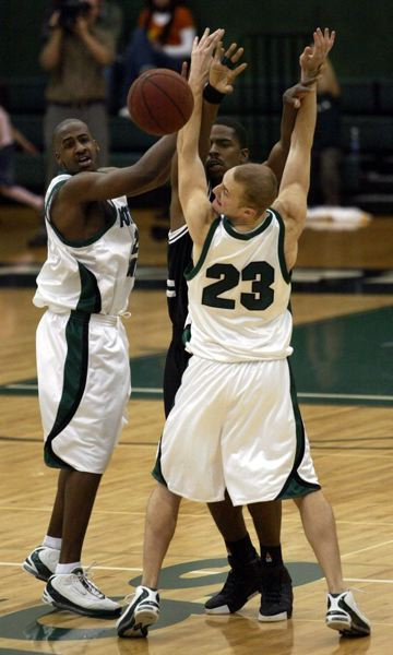 by: TRIBUNE FILE PHOTO: JIM CLARK - In a December 2004 games, Portland State's Will Funn (left)  and Jake Schroeder put the pressure on Warner Pacific forward Donny Woods. Portland State won 85-69, then went on to capture the Big Sky regular-season crown.