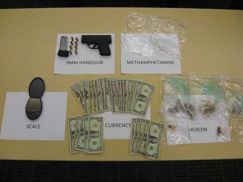 by: SUBMITTED PHOTO - Sherwood Police say they confiscated these items during a traffic stop on Friday night. The driver and passenger of the car face drug and gun-related charges.