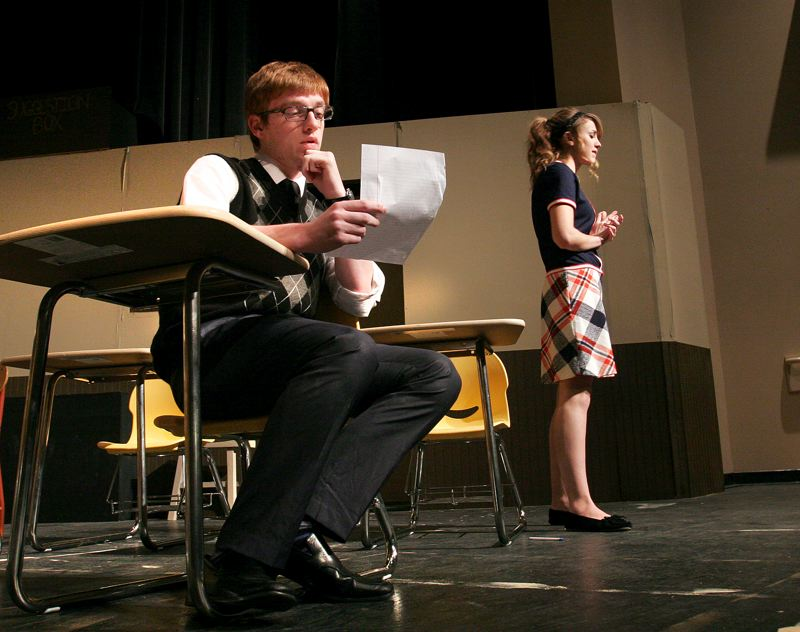by: OUTLOOK PHOTO: JIM CLARK - Paul Barringer, played by Spencer Glaubitz, reads a love letter written by his student, Alice Blake, played by Sierra Graham.