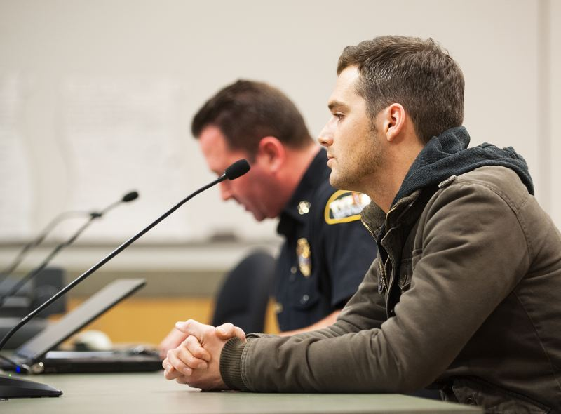 by: SPOKESMAN PHOTO: JOSH KULLA - Tom Smith,right, and TVF&R Division Chief Brian Sherrard, left, speak to the Wilsonville City Council at a presentation to honor Smiths awareness in saving the life of philanthropist Arlene Schnitzer at a Wilsonville Burger King.