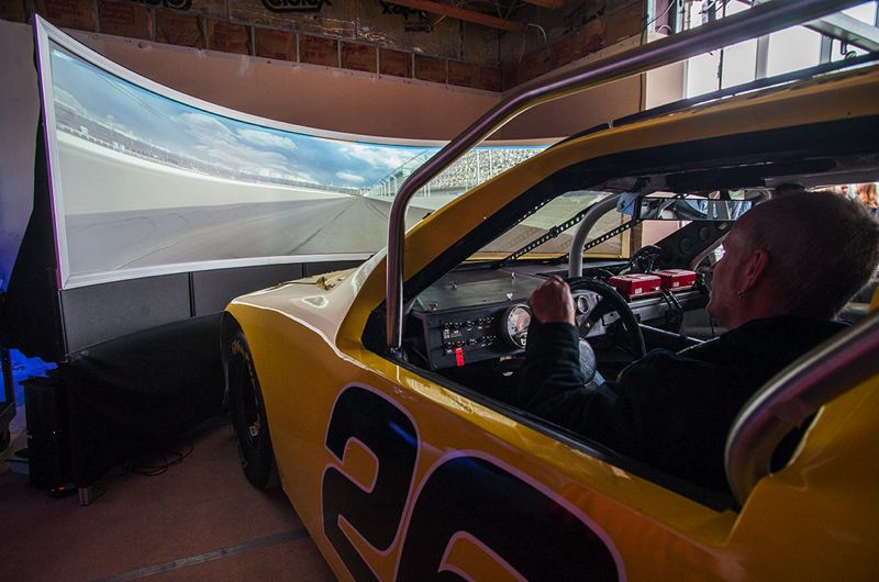 by: SPOKESMAN PHOTO: JOSH KULLA - This simulator built by Hillsboro firm Maher Solutions will provide a fun - as well as educational - driving experience when the World of Speed opens later this year.