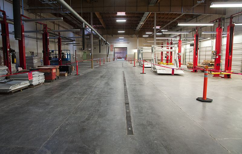 by: SPOKESMAN PHOTO: JOSH KULLA - Construction is well underway on the World of Speed motor sports museum in Wilsonville, where it is slowly filling the 80,000-square-foot former Dodge-Chrysler dealership on Southwest 95th Avenue.