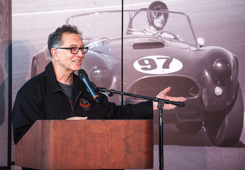by: SPOKESMAN PHOTO: JOSH KULLA - Tony Thacker, shown here speaking at the groundbreaking event at the World of Speed in Wilsonville, plans to combine history and education at the new motor sports museum.