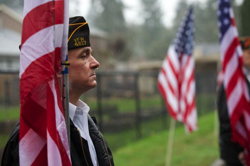 by: TIMES PHOTO: JAIME VALDEZ - Patriot Guard Rider James Allensworth of Beaverton stands at attention prior to Monday morning's funeral service for U.S. Army Spc. John A. Pelham at the Church of Jesus of Christ of Latter-day Saints in Beaverton.