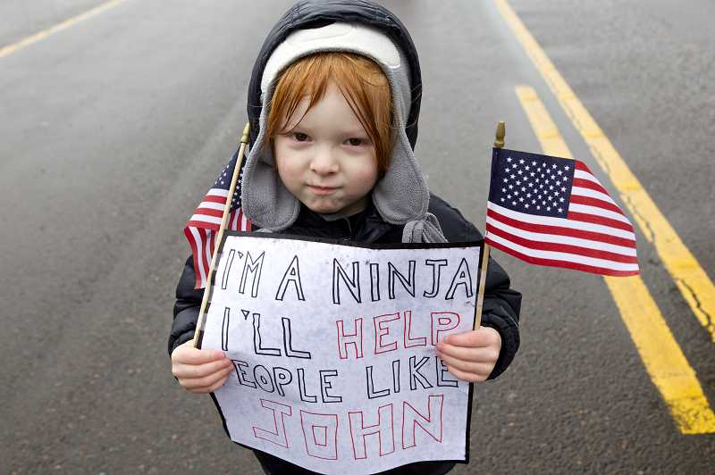 by: TIMES PHOTO: JAIME VALDEZ - Case Bodmer, 4, made a sign in honor of U.S. Army Spc. John Pelham after his mother told him the story of how the Beaverton soldier died while serving his country.
