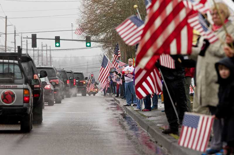 by: TIMES PHOTO: JAIME VALDEZ - As the funeral procession made its way from the Church of Jesus Christ of Latter-day Saints on Southwest 99th Avenue in Beaverton to Willamette National Cemetery, it was sent off with an outpouring of community support.