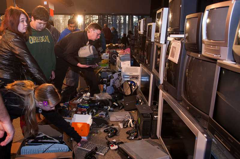 by: SPOKESMAN FILE PHOTO: JOSH KULLA - Home electronics, yes, some of it vintage, are among the treasures to be unearthed at the annual rummage sale.