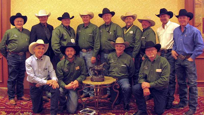 by: SUBMITTED PHOTO - During the PRCA convention in Las Vegas, Nev., Dec. 4, the Canby Rodeo was honored with a pair of awards. Picking up those awards were: (From left) Jim Williams, rodeo director, Keith Marrington, with the Calgary Stampede, Clay Rhoades, Dave McDonald, Dick Eagle, Dan Mickelsen, Paul Borgen, Donny Kish and Tim Birdwell, of Growney Brothers Stock Contractors. (Front Row from left) John Growney, Jeff Robinson, A.J. Swaim and Gary Linton. (not pictured) are directors Jackie Bates, Rick Kauffman, Todd Gary, Lyle Hendrickson, Steve Johnson, Bob Traverso and Doc Rosebrook.