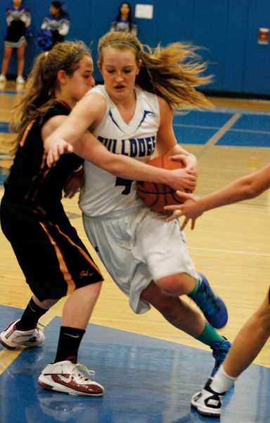 by: PHIL HAWKINS - Woodburn's Lizzy Ellingson led the team with a game-high 17 points against Crescent Valley, helping to give the Bulldogs their most lopsided victory of the season Friday night.