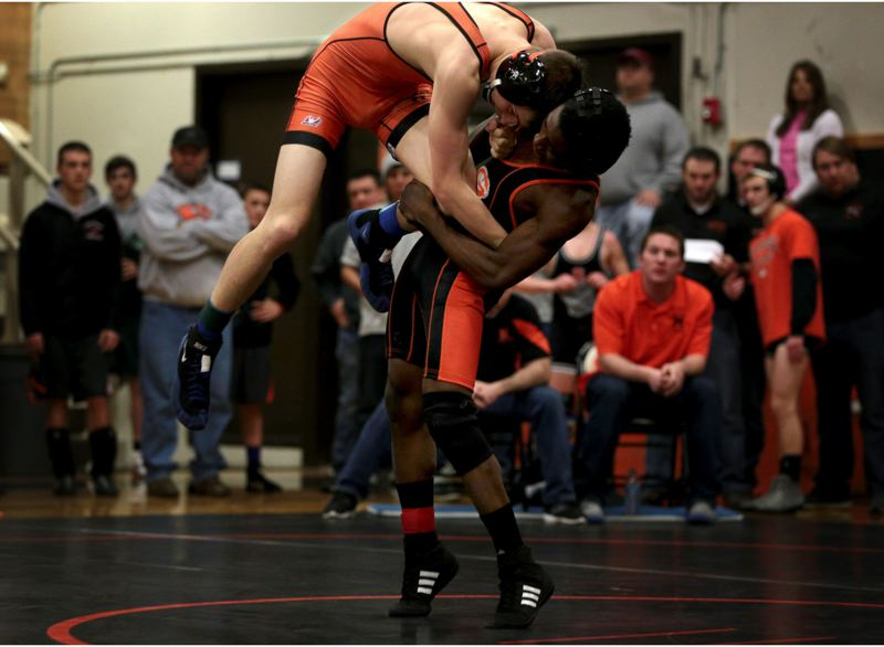 by: JON HOUSE - Gladstone senior Jachael McMillon (120) takes Molallas Adam Keller for a ride en route to a 9-7 decision in Saturdays semifinals of the 4A Special District 1 Regional Wrestling Tournament, held at Gladstone.