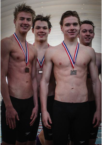 by: BRIAN SEE - Oregon City swimmers display their hardware after a strong swim in the 200-medley relay at last weekends Class 6A State Swim Meet. Pictured, from left, are Chase Tucker, Isaac Watt, Brian Frazier and Josh Morton.