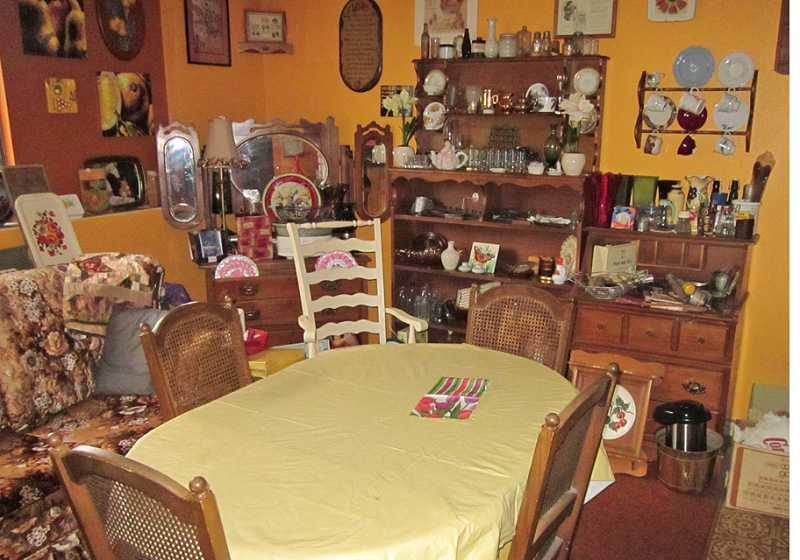 by: BARBARA SHERMAN - A LIFETIME OF COLLECTIBLES FOR SALE - In the lower level of the Purkey's Tax Service building, a real kitchen has been transfirmed into a display kitchen featuring antique kitchen utensils and knickknacks.