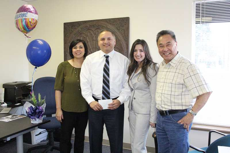by: LINDSAY KEEFER - Anthony Veliz (second from left) was surprised Friday afternoon with the announcement that he is this year's Junior First Citizen. He is flanked by his wife, Melinda Veliz (left), Woodburn Area Chamber of Commerce's board president Amanda Pratt (second from right) and the chamber's executive director Harry Lee Kwai.