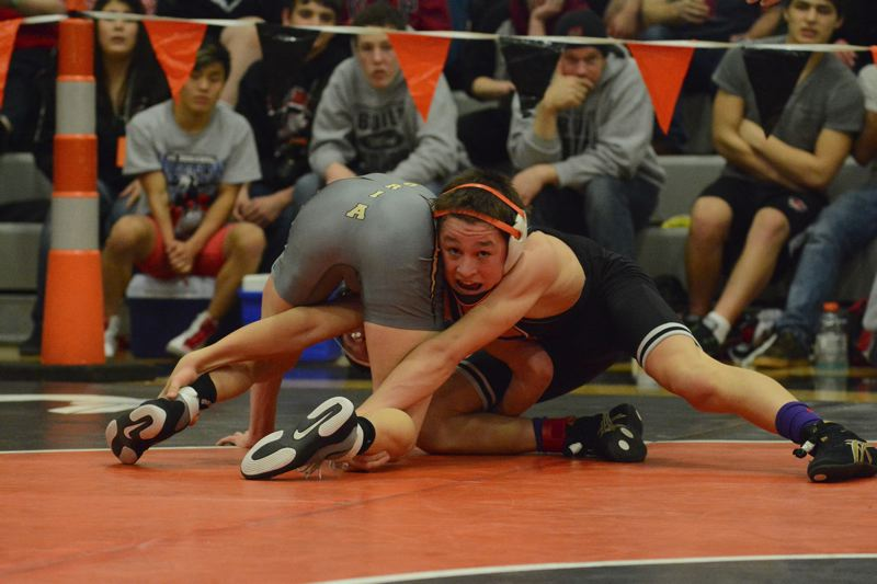 by: JOHN WILLIAM HOWARD - Sophomore Braxton Sue wrestles during the finals of the 106-pound bracket at the 4A District 1 regionals. Sue finished first in his bracket, and will head to the state championships with the top seed.