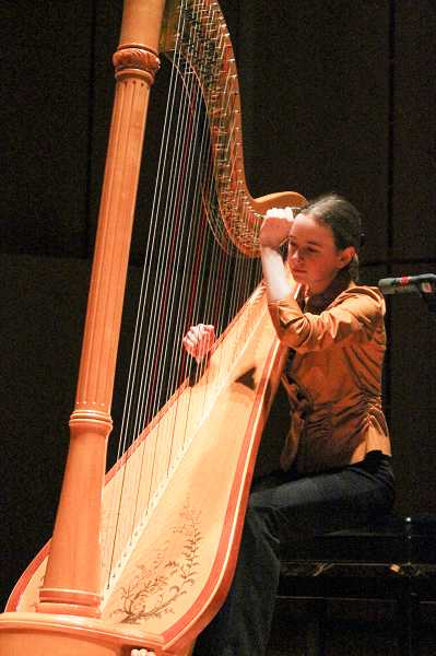 by: NEWS-TIMES PHOTO: JOHN SCHRAG - Pacific University student and harpist Felicity Dyall came 'all the way from Portland,' according to emcee Pete Truax, to perform 'Sabre Dance' by Susan McDonald.