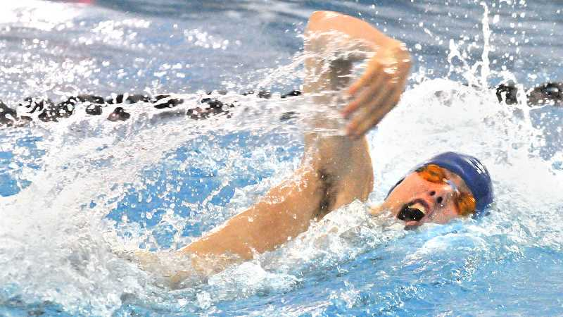 by: SETH GORDON - Splash - Corbin Day thrashes his way across the pool as part of Newberg's 400 freestyle relay team Saturday at the OSAA 6A state finals at Mt. Hood Community College in Gresham. The Tigers placed eighth.