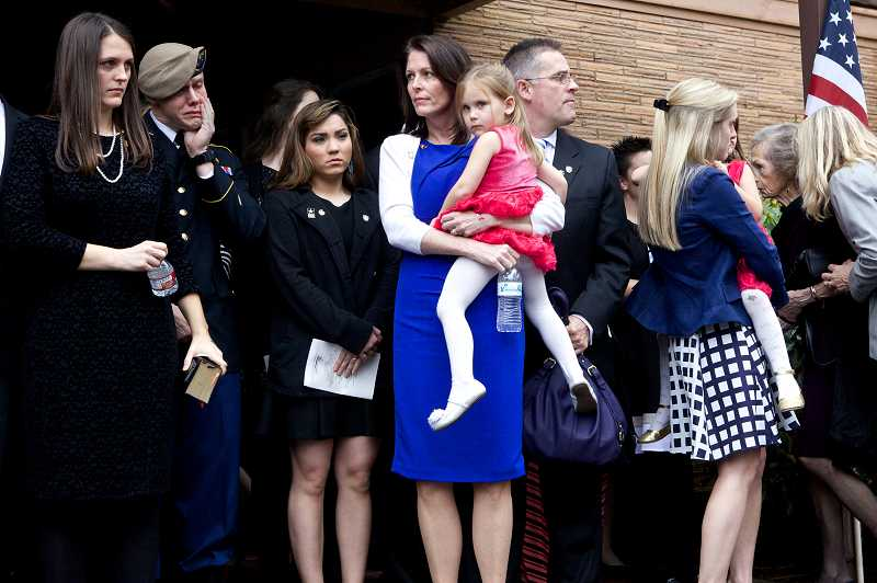by: PAMPLIN MEDIA GROUP PHOTO: JAIME VALDEZ - The family of Army Spc. John Pelham emerges from the Church of Jesus Christ of Latter-day Saints on Southwest 99th Avenue in Beaverton after his memorial service Monday.