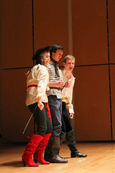 by: NEWS-TIMES PHOTO: JOHN SCHRAG - (Left to right) Emma Coffey, Aaron Orr and Noah Wilson-Fey, all Forest Grove High School students, sing 'Paradox' from the upcoming school musical, 'Pirates of Penzance.'