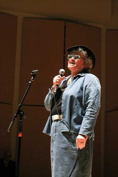 by: NEWS-TIMES PHOTO: JOHN SCHRAG - Bonnie Thomas sings 'God's Country,' a song written by her son, who usually joins her in harmony but was in New Jerseyat the time of the show.