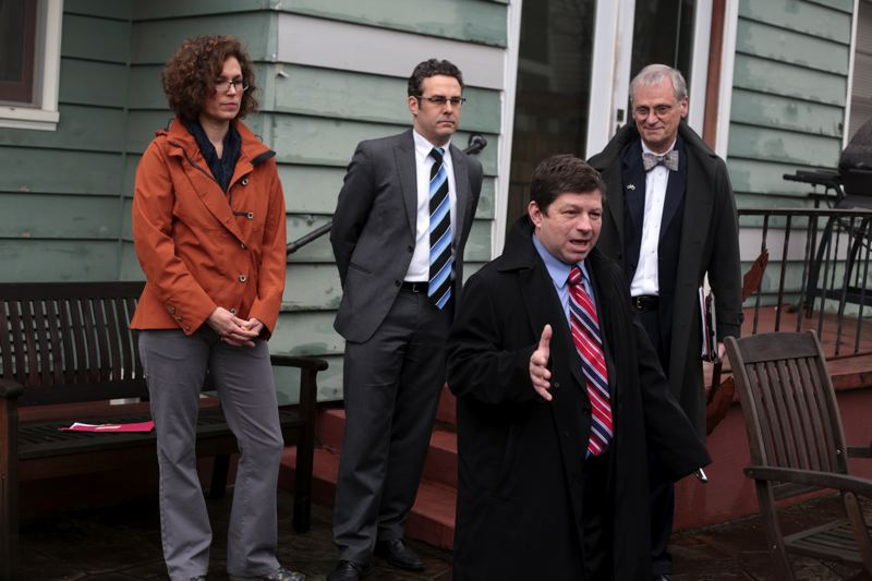 by: TRIBUNE PHOTO: JONATHAN HOUSE - Within days of the winter storm, Commissioner Steve Novick was talking about the importance of earthquake-proofing homes for the expected Big One. Behind him are homeowner Stacy Schubert, Clean Energy Works Executive Director Derek Smith and Congressman Earl Blumenauer.