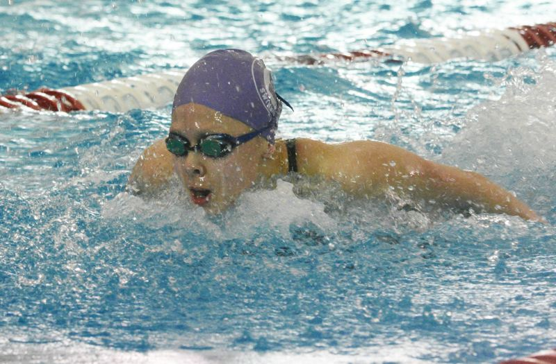 by: TIMES PHOTO: MATT SINGLEDECKER - Sunset girls swimmer Megan Lam placed fourth in the 200 individual medley to help the Apollos take fourth as a team the 6A state championships.