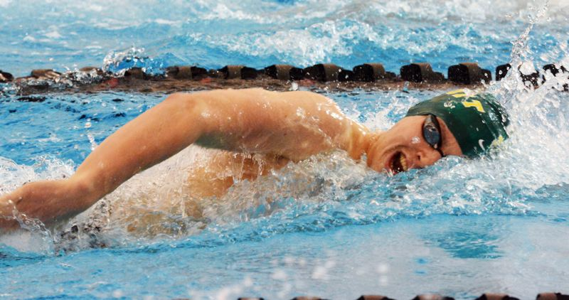 by: TIMES PHOTO: MATT SINGLEDECKER - Jesuit senior Jackson Wahl scored 12 points for the Crusaders by taking third in the 200 freestyle.