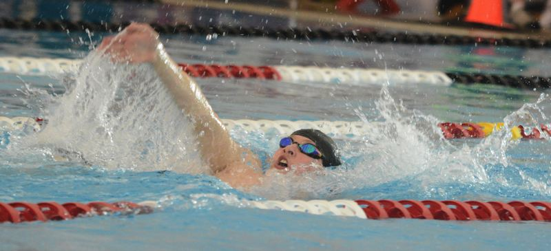 by: TIMES PHOTO: MATT SINGLEDECKER - Southridge boys swimmer Patrick Mulare set two new state records in the 200 individual medley and the 100 backstroke at the 6A state championships on Saturday.