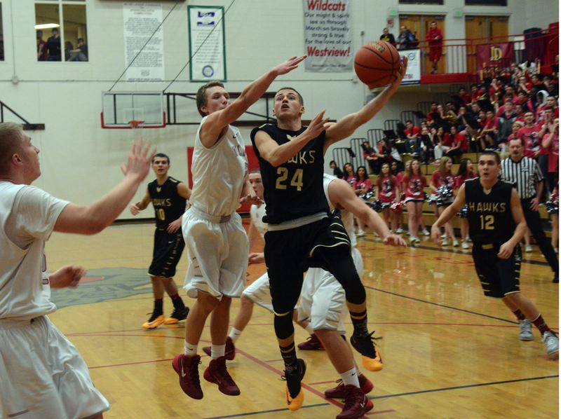 by: TIMES PHOTO: MATT SINGLEDECKER - Southridge senior guard Hudson VanAllen makes his way to the hoop against Westviews Ben Larsen for two.