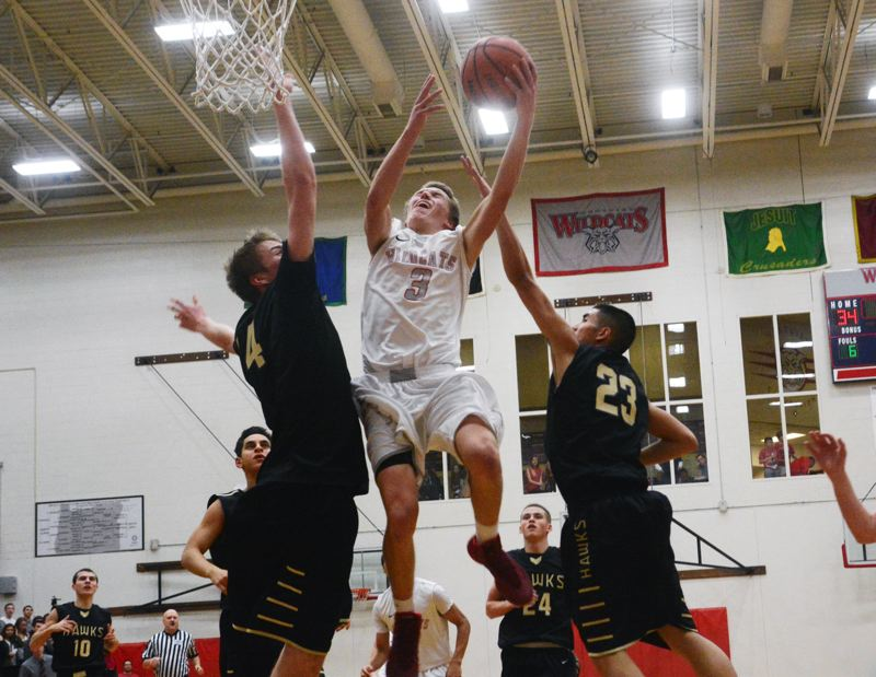 by: TIMES PHOTO: MATT SINGLEDECKER - Westview senior guard Ben Larsen scored 13 first half points for the Wildcats. Larsen led Westview with 15.