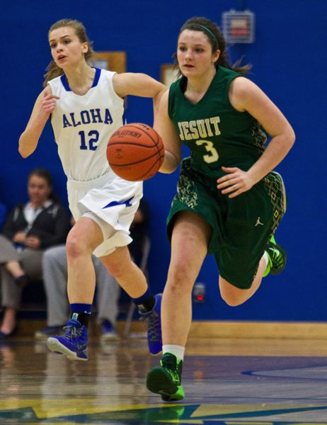 by: TIMES PHOTO: JAIME VALDEZ - Jesuit Crusaders wing Connie Parker (3) heads up court against Aloha Warriors guard Noheaililani Waiwaiole (12) in the first half at Aloha High School.