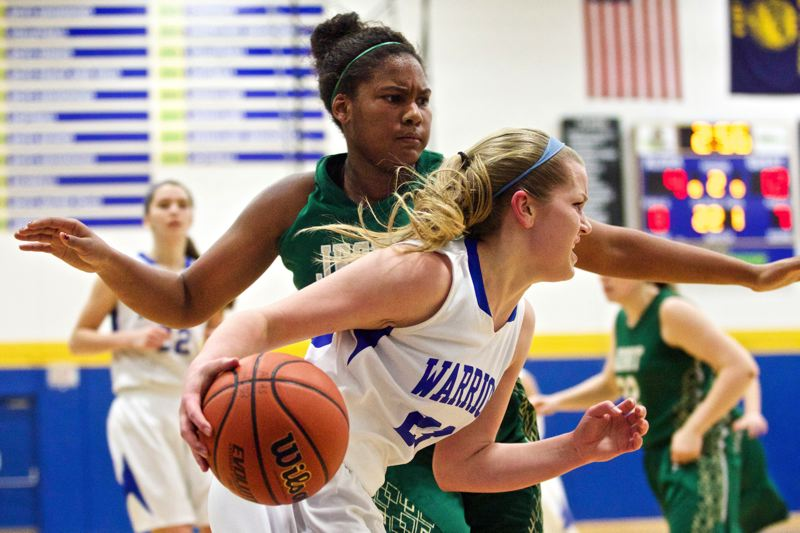 by: TIMES PHOTO: JAIME VALDEZ - Aloha Warriors guard Mackenzie Sibert (20) drives he baseline against Jesuit Crusaders power forward Alzena Henry (25) in the first half at Aloha High School.