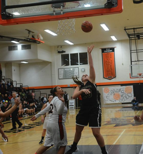 by: TIMES PHOTO: MATT SINGLEDECKER - Southridge junior post Margaret Brock floats up a left-handed floater for two against Beaverton.