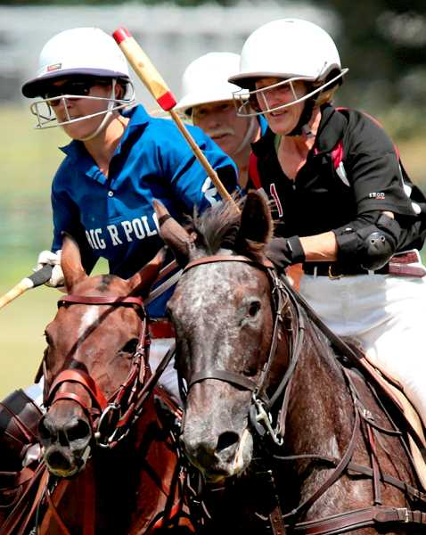 by: SUBMITTED PHOTO: J. ANDREW TOWELL - The excitement of a polo match is shown close up. The game is coming back to Oswego Hunt after an absence of 40 years. Instructor Claudia Howell is shown riding at the right.
