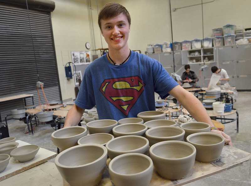 by: REVIEW PHOTO: VERN UYETAKE - Lakeridge junior Will Larson is one of the ceramics students making dishes for Empty Bowls.