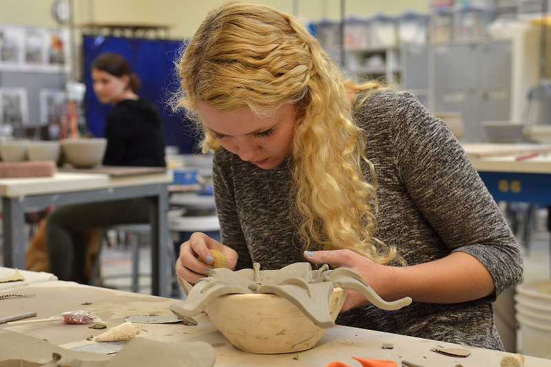 by: REVIEW PHOTO: VERN UYETAKE - Abbey Rooney, a 12th-grader at Lakeridge, said she had to take a sculpture class to be able to properly construct a free-hand bowl.