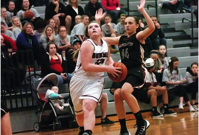 by: DAN BROOD - ON THE DRIVE -- Sherwood sophomore guard Josie Funk gets past Milwaukie's Alexa Mulford and looks to go to the basket in last week's game.