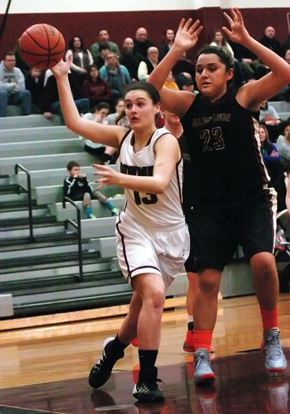 by: DAN BROOD - IN REACH -- Sherwood junior post Mallory Shields (left) reaches for the ball in front of Milwaukie's Merrily Jones.