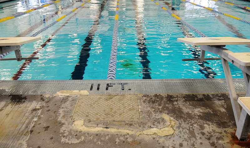 by: REVIEW PHOTO: VERN UYETAKE - The concrete surface is broken in a few areas around the pool.