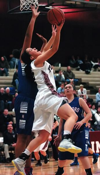by: DAN BROOD - BEHIND THE HOOP -- Tualatin senior post Jasmine Miller goes up for a reverse layup in Tuesday's game.