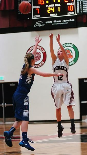 by: DAN BROOD - BOMBS AWAY -- Tualatin senior Madi Hall sank four three-pointers in Tuesday's game.